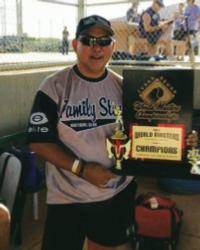 Percy playing softball - Generations Magazine - February-March 2013