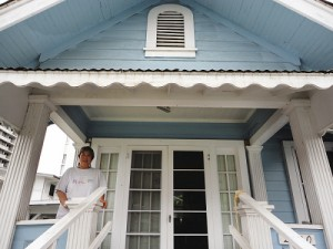 Osajima at the front porch of Project Dana office and doing an orientation inside with volunteer Ashley.