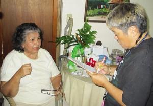 Osajima working with seniors.