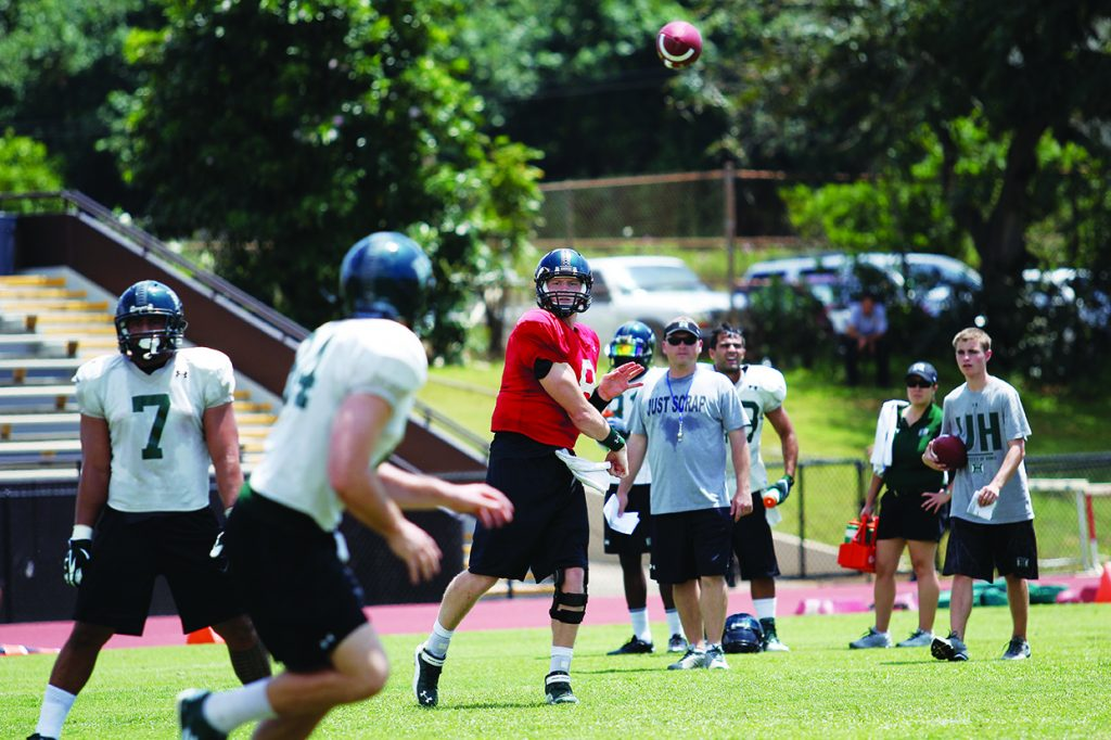 Football Players Scrimmage - Generations Magazine - June - July 2013