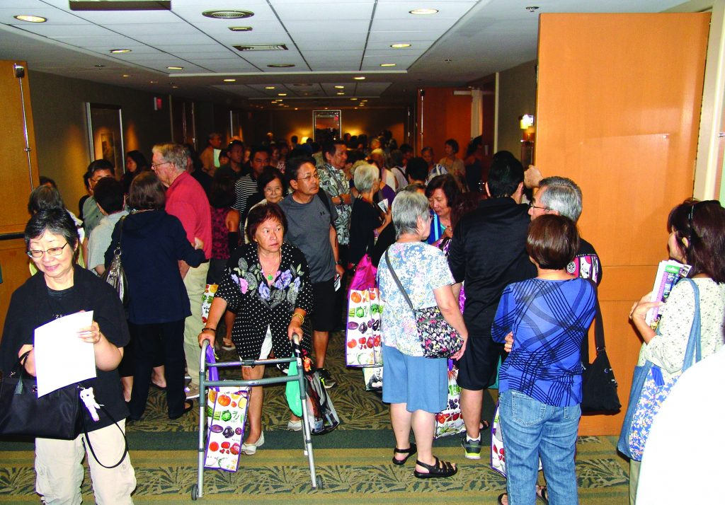 "(Above) In between sessions, attendees filled the hallways of the Ala Moana Hotel. More than 3,000 people were at this year's event. (Below, left) A well-attended session this year was, ""Improving Life At Home For Caregivers & Elders"" by Dr. Michael Cheang, an assistant professor at the University of Hawai'i at Ma¯noa Center on Aging."
