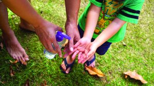 After playing, help grandchildren wash their hands with soap and clean water.