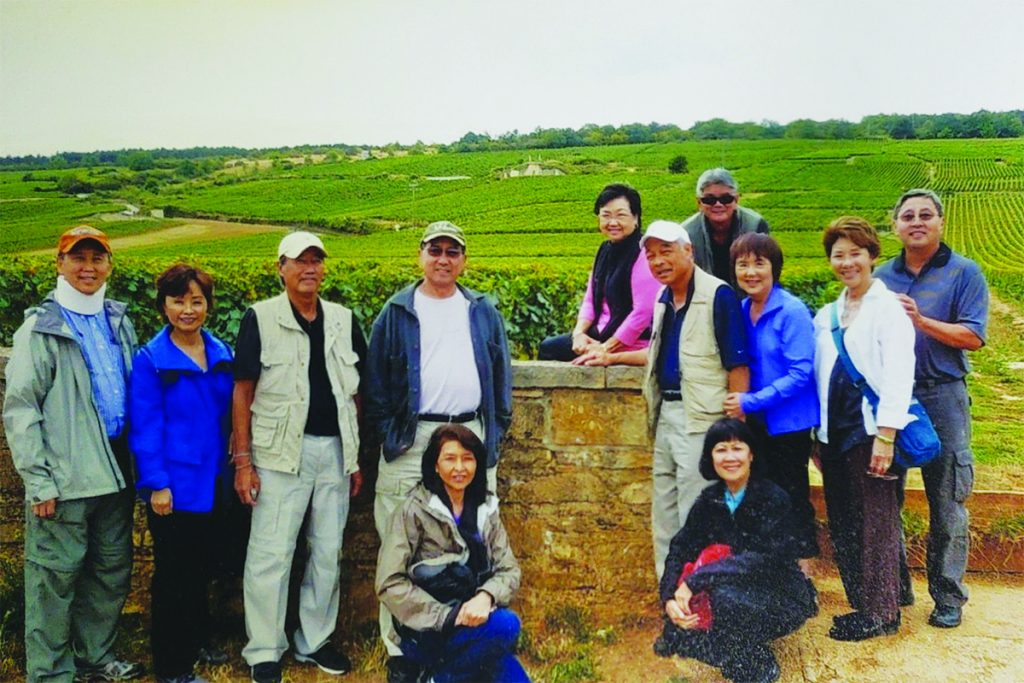 World Class Vineyards in Bourgogne, France.  Kneeling: Annette Pang and Kathleen Ching, Middle: Ronald & Penny Mau, Russell Ching, Wendell Pang, Steve & Tina Chung, Cynthia & Guy Seu, Back: Loretta & Tyler Yajima