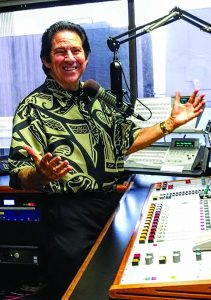 """Harry B. Soria, Jr. broadcasts """"Territorial Airwaves"""" in a modern studio. Above: Young traditional musicians Raiatea Helm and Nā Hoa tapped into Harry B.'s territorial music collection to discover authentic vintage tunes and lyrics that helped them develop their successful careers."""
