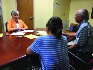 Photo of Lori Protzman, RN, coordinator for the Queen's Advance Care Planning Clinic, meets with adults and families to discuss healthcare planning, quality-of-life values and choices, and related documentation to ensure wishes are followed.