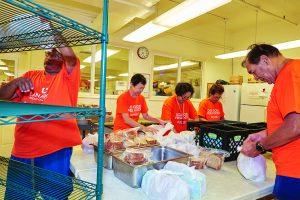 Lanakila Meals on Wheels packing individual meals