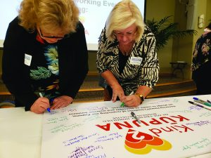 Dawn Calpito of Kala¯kaua Gardens, Kathy Wyatt of Hale Hau'oli Hawaii, and other organizations and companies attending a Sept. 17 breakfast event