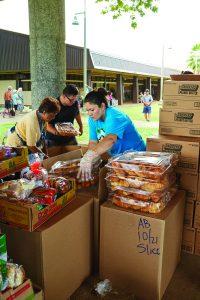 Hawaii Foodbank preparing donated food to distribute