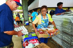 PHOTOGRAPHS OF HAWAII FOODBANK'S DONATIONS TO DYNAMIC COMPASSIONS IN ACTION/OHANA PRODUCE PLUS AND DCIA/OPP FOOD DISTRIBUTION PROGRAM AT THE WAIMANALO DISTRICT PARK.