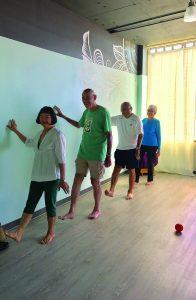 (L–R) Elvira Lee, Tom Glass, George and Grace Lee work on optimal posture, balance and coordination.