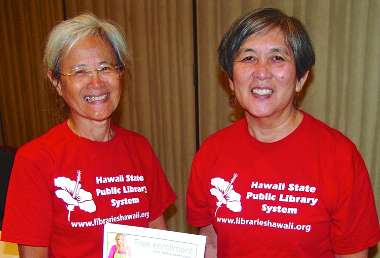 Employees of the Hawai'i State Library promoted their new app and other programs for library cardholders: (L–R) Colette Young and Miriam Sato.