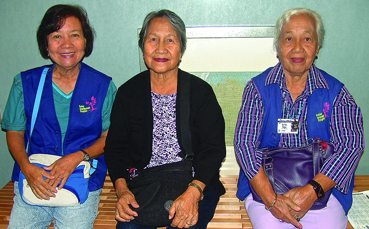(L–R) Dalisay Quijano, Lolita Mendoza and Erlita Corpus volunteer 15 hours per week with the Foster Grandparents Program, assisting local children with special needs.