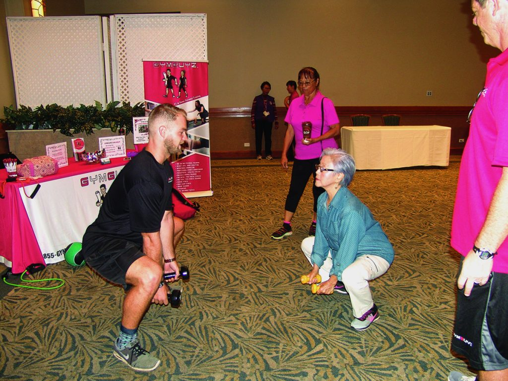 Kurtis Ackerman, a personal trainer with GYMGUYZ, did weighted squats with Joanne Pyun, while Charlotte Lyman watched. GYMGUYZ brings personal training to clients' homes.