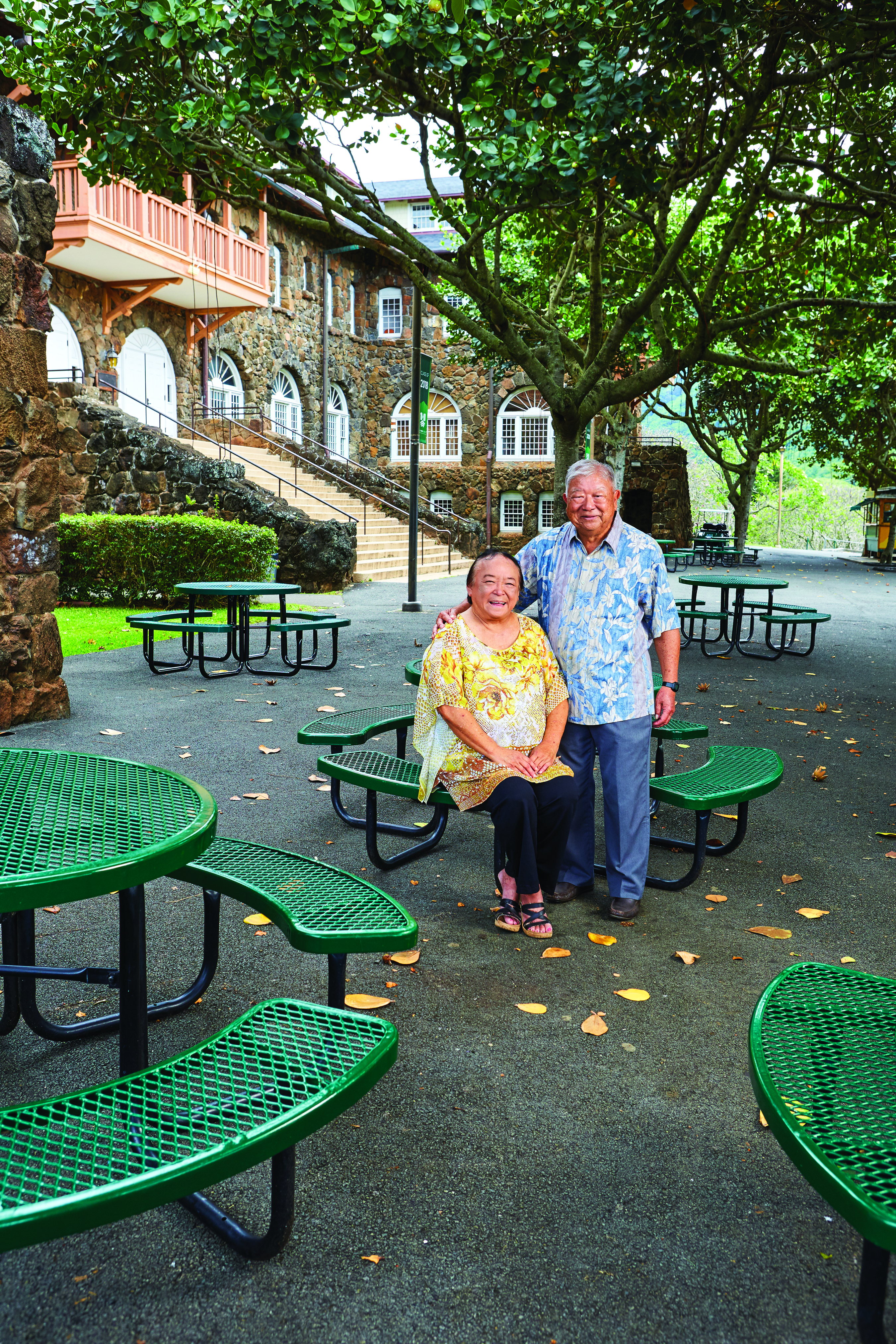 Dottie Crowell and Galen Narimatsu in the courtyard of historic Kawaiha'o Hall. The Hall was built in 1908 when the Kawaiha'o Seminary for girls and the Mills Institute for boys moved to their new joint campus in Ma¯noa, known as the Mid-Pacific Institute.