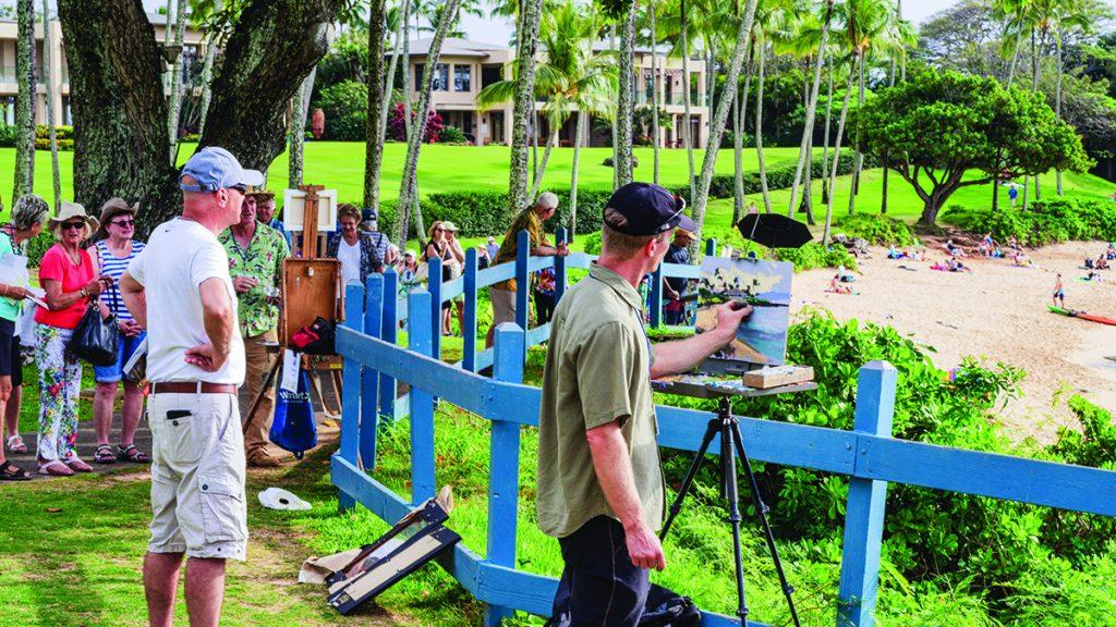 Spectators gather to watch plein air artists create their magic.