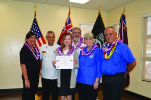 "The 2020 State of Hawai'i VFW Voice of Democracy (VOD-HI) winner is Alexandrea Wong (holding certificate), a high school senior at St. Andrews Priory, for her four-minute audio essay on ""What Makes America Great."" She was awarded a $500 check, VFW certificate and an all-expense-paid trip to Washington, D.C., to compete nationally for a $30,000 VFW first-place scholarship paid directly to a university, college or technical/ vocational school. Also pictured (L–R) are George Barlett, chair, VOD-HI; James Kahalehoe, commander, Windward O'ahu Post 10154; Ron Lockwood, VFW-HI acting commander; Gerri Enos, VFW-HI Auxiliary VOD chair; and Take Shiroma, president, VFW-HI Auxiliary."