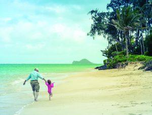 A Girl With Her Grandad On A Tropical Beach