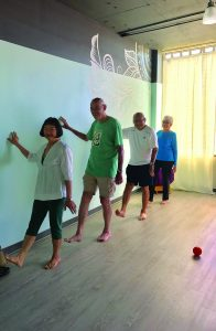 (L–R) Elvira Lee, Tom Glass, George and Grace Lee work on optimal posture, balance and coordination.