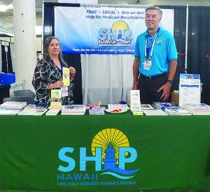SHIPMates Carol and Stephen explain Medicare to fair attendees.